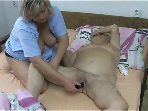 Nurse gives granny lesbian pleasure with toy