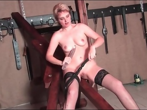 Kinky mature beauty flogged on her ass