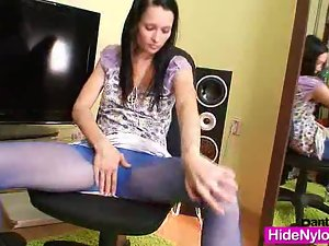 Slim teen in blue nylon tights toys herself