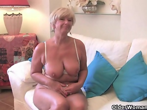 Granny with big tits masturbates with her sex toy collection