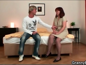 Mature redhead gobbles his cock lustily