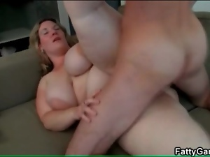 He grabs her fat and fucks her hot hole doggystyle