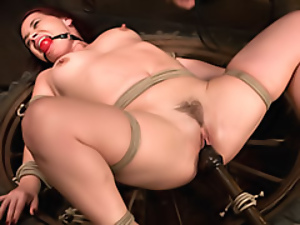 Bound girl in a ball gag