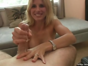 Smiling wife jerks the jizz from a dick