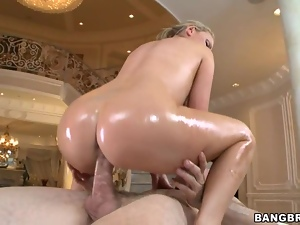 Oiled babe Nikki Benz rides her pussy on this hard dick