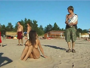 Beautiful fresh faced teen plays at the beach nude