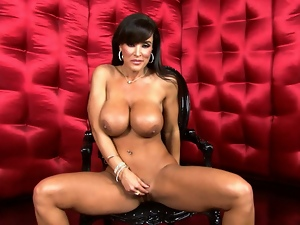 Stunning Lisa Ann exposes her huge succulent tits