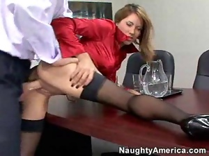 Brunette gets fucked on a office desk