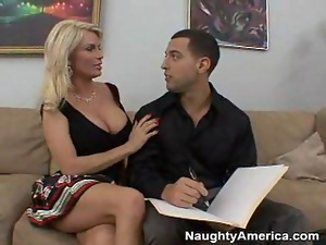 Busty blonde cougar fucks a hard young cock
