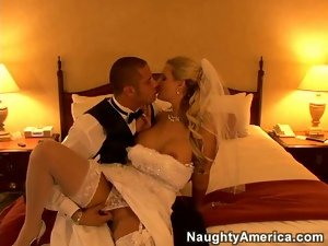 Blonde bride in white gown undresses and fucks on bed