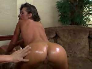 Sexy brunette gets oiled up and she sucks dick and balls