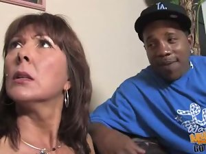 MILF gets gangbanged by hung blacks