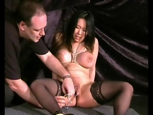 Clamping down her pussy lips for pain
