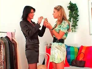 Stylist helps hot chick pick out lovely outfit