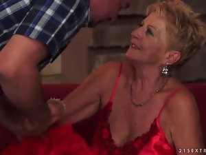 Going down on old lady in sexy satin lingerie
