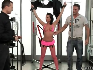 Girl in porn store bound and flogged lightly