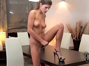 Girl on table takes her pussy with a toy