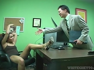 Upskirt and footjob tease in her office
