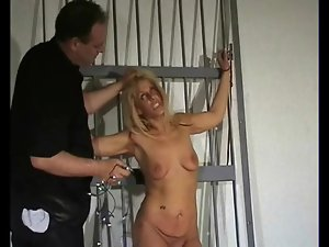 Bound girl takes a touch of nipple pain