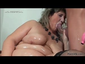 Fat chick coated in milk and oil gives him a titjob