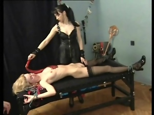 Bound slaves in the dungeon of sexy mistress
