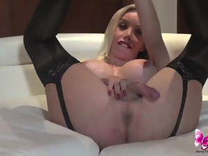 Ana Mancini in black stockings and heels