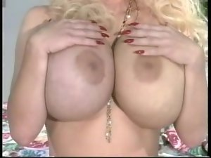 Gigantic fake titties and hairy pussy on a blonde