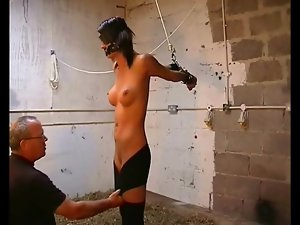 Blindfolded and bound girl with big fake tits