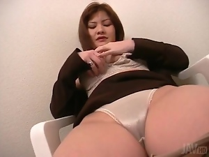 Rubbing her pussy through satin panties