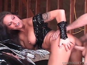 Biker slut in latex clothes fucked from behind