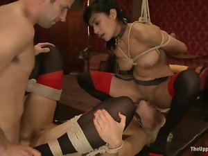 Two cute chicks get tied up and fucked by the insatiable stud Maestro