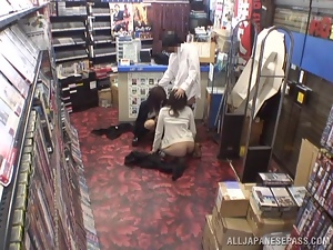 Two insatiable Japanese bitches share a cock in a shop