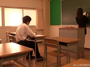 Teacher Chihiro Akino Gets Photographed while Sucking Cock in Class