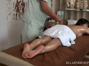 Oiled up Japanese girl gets fucked by her masseur