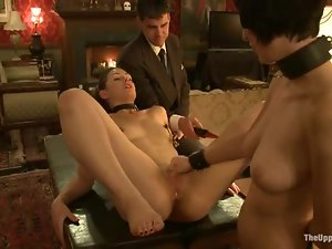 Two sex slaves fuck each other pussies and mouths with strap-on