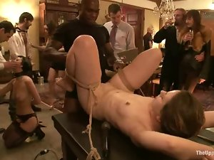 Tied up girl lies on a table getting toyed and fucked