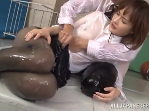 Totally Oiled Up Japanese Girl in Clothes and Pantyhose Sucking Cock