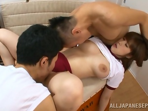 Sporty Japanese girl Mizuki enjoys sucking and riding two cocks