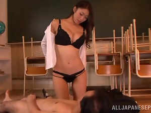 Hot teacher Reiko Kobayaka has fun with her colleague in a classroom