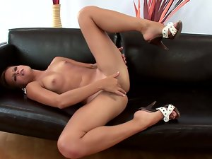 Sizzling chick Jo enjoys playing with her pussy indoors