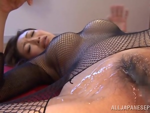 Gorgeous Asian babe Reiko is acting dirty in her fishnet suit