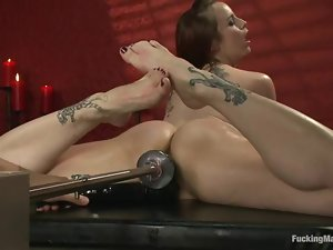 Bella gets drilled by a machine in bondage