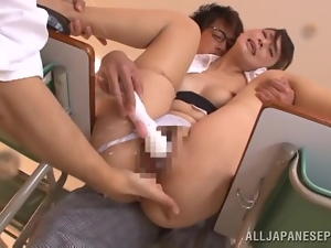 Horny Japanese teacher gets fucked right in a classroom