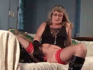 Trashy mature in fishnets masturbating with sex toys