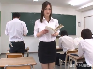 Japanese teacher Sayuki Kanno demonstrates her boobs to her students