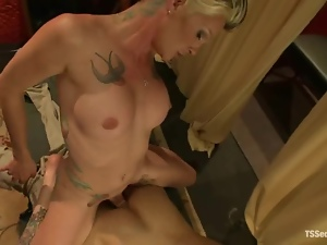 Tattooed transsexual is penetrating her masseur