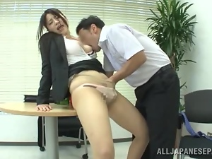 Naughty Japanese office girl gets fucked on a table