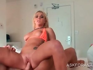Excited blonde hottie riding loaded pecker in bed