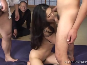 Pretty Risa Murakami has hot threesome sex on public