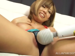 Big-breasted Japanese milf moans sweetly while getting her cunt toyed